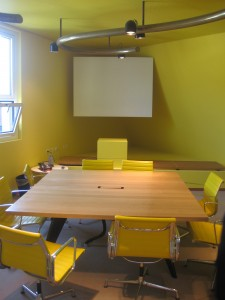 The yellow room at Vitra HQ in Basel with EA 108 from Charles and Ray Eames.