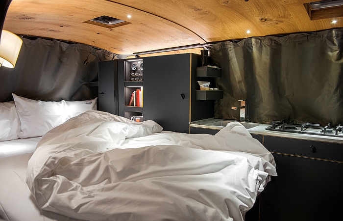 The bedroom of the Holzklasse by Nils Holger Moormann & CustomBus (bed linen included)