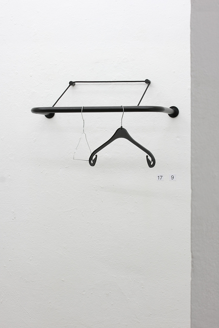 A black plastic and ametal coat hook - presented on the Gravity coat rack, as seen at Thomas Schnur - 21 Common Things