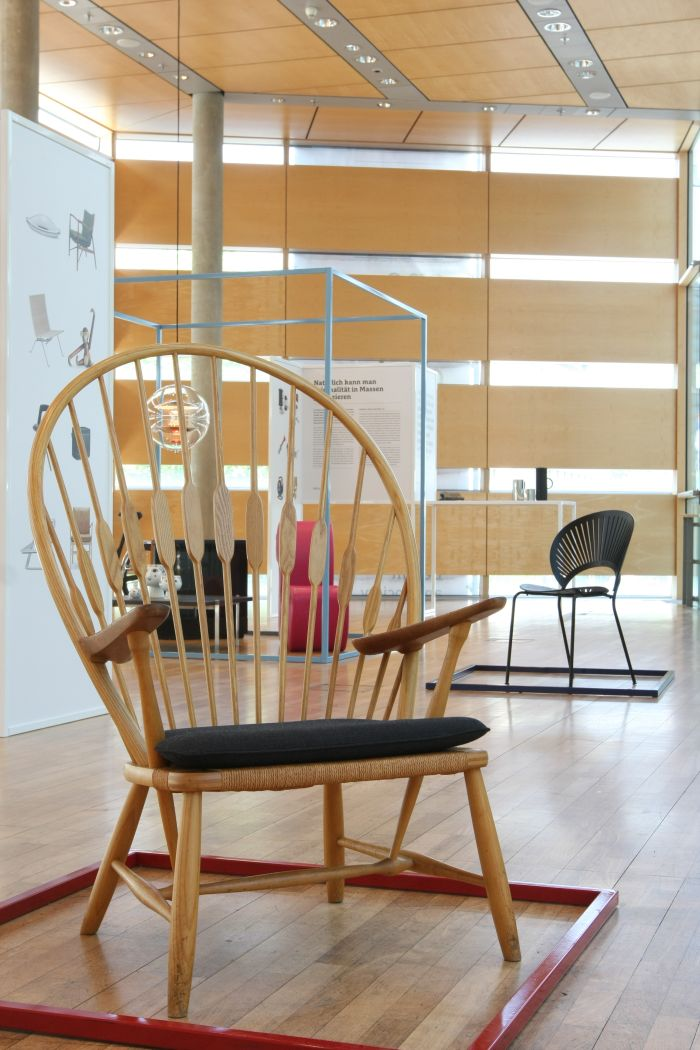 Peacock by Hans J. Wegner (foreground), Trinidad Chair by Nanna Ditzel (background), as seen at Much More Than One Good Chair, Felleshus Berlin