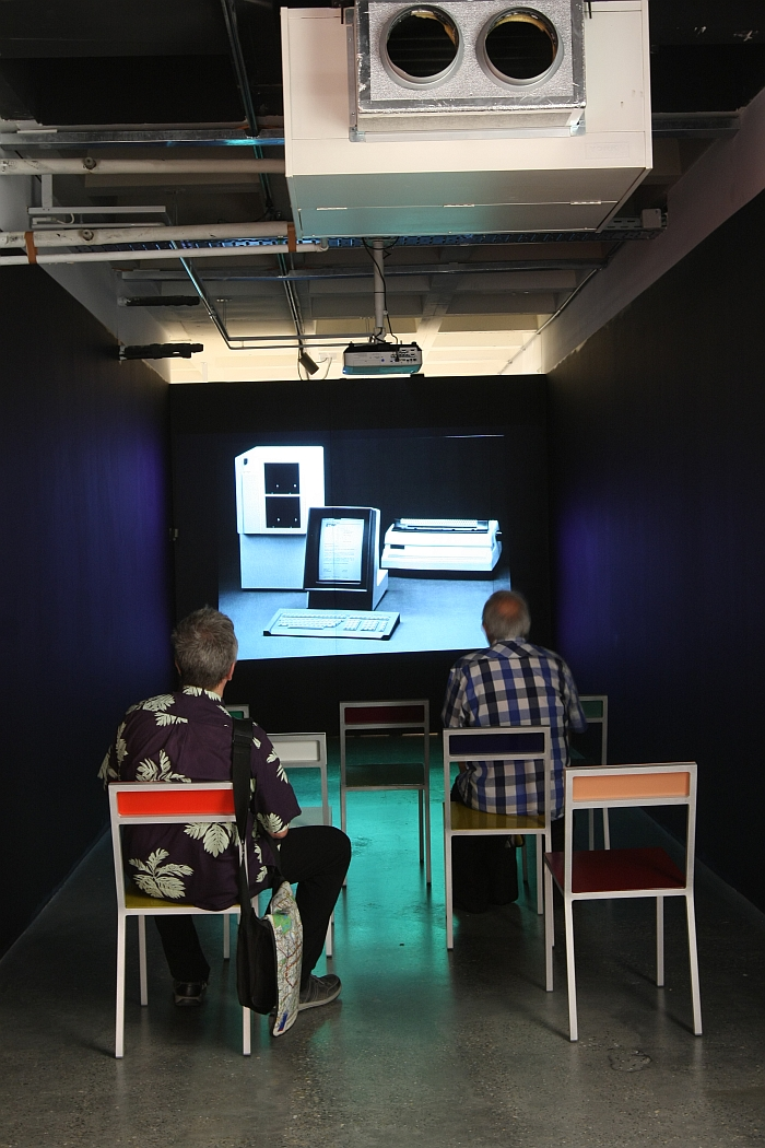 Viewing archive images of Brussels Design Centre, in the comfort of Müller van Severen chairs, as seen at Panorama. A History of Modern Design in Belgium, ADAM Brussels