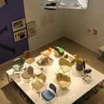 A collection of fibre glass chairs - and a video explaining the production, as seen at Charles & Ray Eames. The Power of Design, Vitra Design Museum