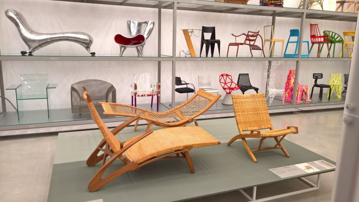 The JH512 folding chair (r.), JH511 Long Dolphin Chair (front) & GE2 Hammock lounger (rear), as seen at Hans J. Wegner: Designing Danish Modern. Vitra Design Museum Schaudepot