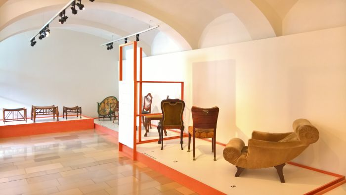 Furniture by Adolf Loos including his moneumental Knieschwimmer easy chair (r.)