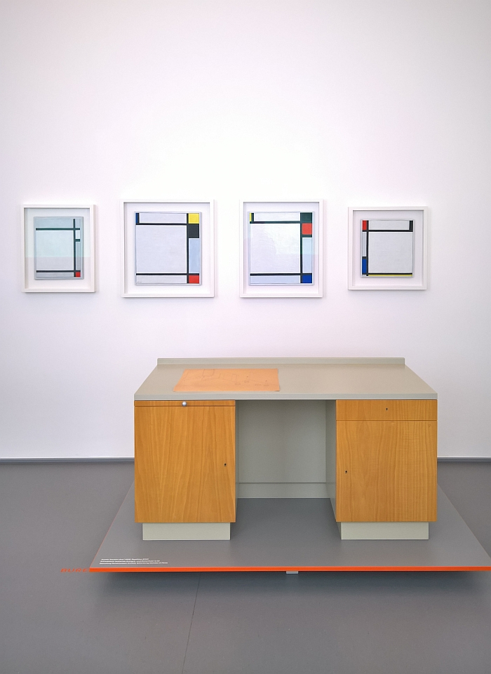 Bureau by Sophie Taeuber-Arp and works by Piet Mondrian, as seen at From Idea to Form. Domeau & Pérès Design and Craftsmanship in Dialogue, Kaiser Wilhelm Museum Krefeld