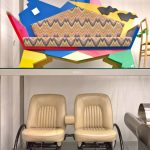 "Which sofa looks more ""domestic""? Kandissi by Alessandro Mendini (top) and Rover 2-Seater 3,5 Litre by Ron Arad (bottom), as seen at Ron Arad. Yes to the Uncommon!, the Vitra Design Museum Schaudepot"