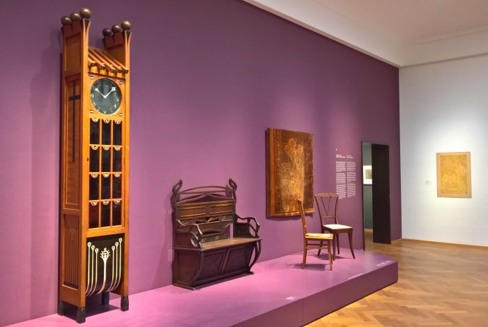 A Longcase Clock Chris Wegerif & bench by Johan Thorn Prikker, all for Arts & Crafts, chairs by Henry van de Velde & Johan Thorn Prikker, as seen at Art Nouveau in Nederland, The Gemeentemuseum Den Haag
