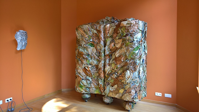 A cupboard crafted from exotic leaves, as seen at Marcin Rusak - Nature of Things II at the Horta Museum, Brussels