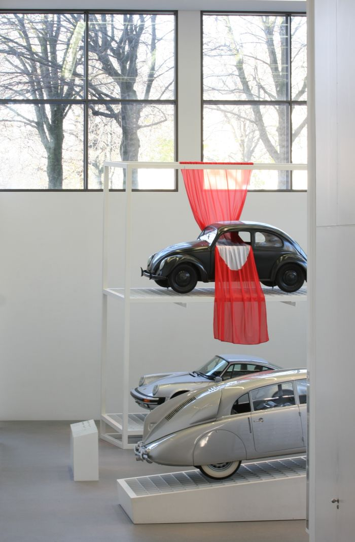 Design Mobilises with a VW Beetle, it's not that flag, but it should give the impression it is, as seen at Friedrich von Borries. Politics of Design. Design of Politics, Die Neue Sammlung Munich