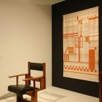 An anoymous chair and weaving by Else Mögelin in a recreation by Studio Aphorisma, as seen at Bauhaus_Sachsen, Grassi Museum für Angewandte Kunst Leipzig