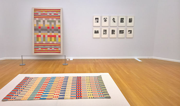 Piano cover by Gertrud Arndt & photos by Marianne Brandt (rear), Children's carpet by Otti Berger (foreground), as seen at Bauhaus. Textiles and Graphics, Kunstsammlungen Chemnitz