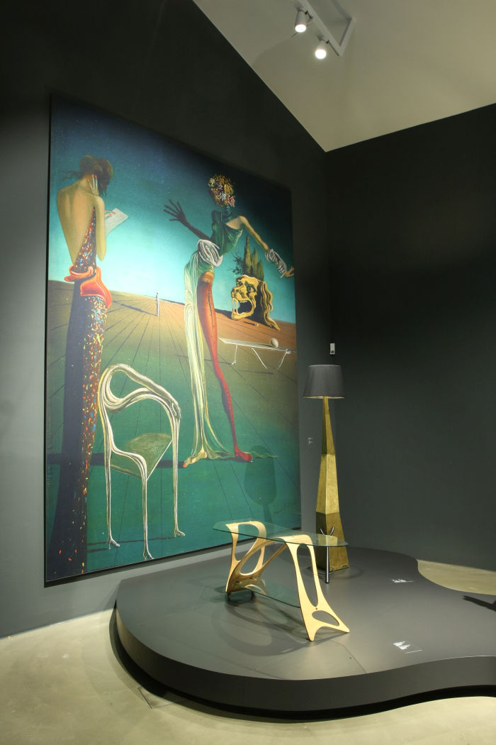 A blow-up of the painting Femme à la tête de roses by Salvador Dalí alongside Arabesco by Carlo Mollino and the lamp Bracelli by Salvador Dalí, as seen at Objects of Desire. Surrealism and Design 1924 - Today, Vitra Design Museum