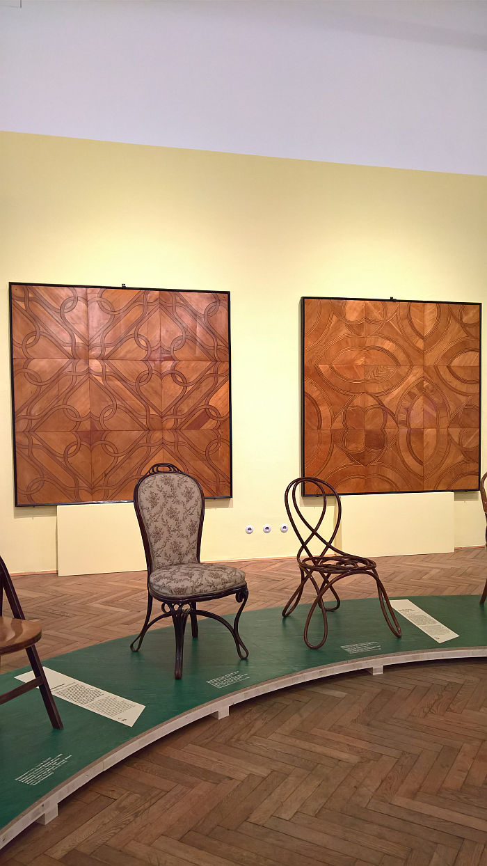 Salon Chair and a bent beech Demonstration Chair as presented by Thonet at the the 1867 World's Fair in Paris, in front of two examples of Thonet parquet work from ca 1855, as seen at Bentwood and Beyond. Thonet and Modern Furniture Design, MAK - Museum für angewandte Kunst Vienna