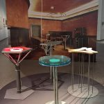 """The four bistro tables developed for Cafe """"Casino"""" at documenta 8, and an image of the interior, as seen at Design Gruppe Pentagon, Museum für Angewandte Kunst Cologne"""