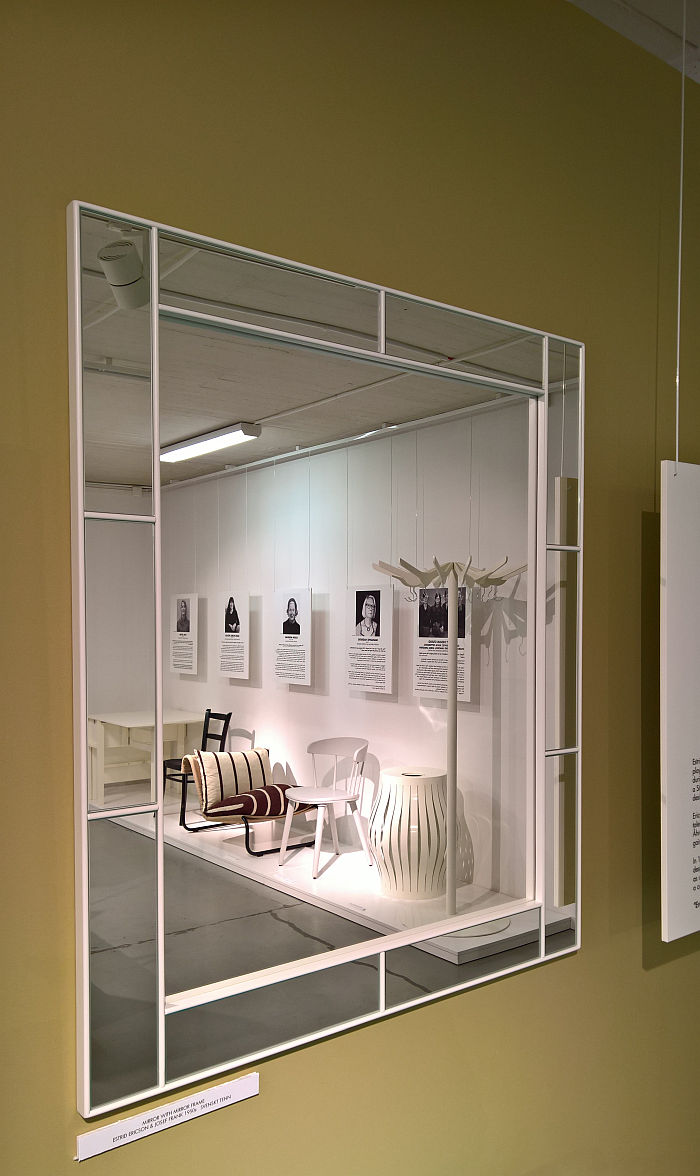 A selection of objects reflected in a mirror by Estrid Ericson & Josef Frank for Svenskt Tenn, as seen at Female Traces, the Museum of Furniture Studies, Stockholm