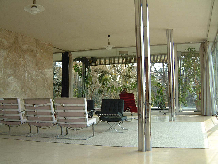 The living room at Villa Tugendhat by Lilly Reich Mies van der Rohe, including in the foreground the Tugendhat Chair (clue: also in all probability primarily Lilly Reich)