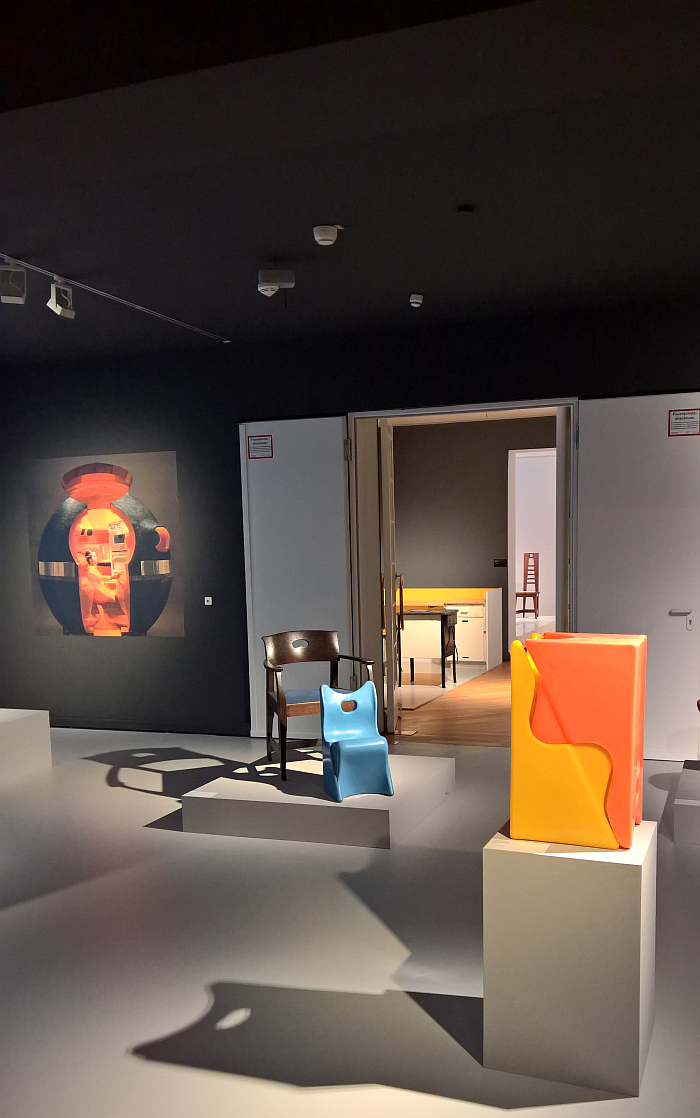 The children's chair Ringnor by Luigi Colani stacked and in dialogue with a 1902 chair by Richard Riemerschmid, as seen at Luigi Colani and Art Nouveau, Bröhan-Museum, Berlin